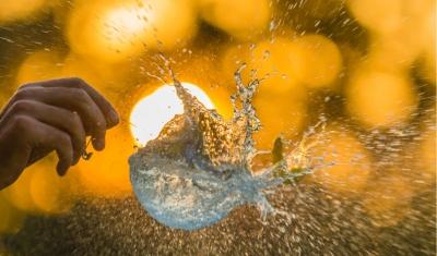 bursting bubble on yellow background