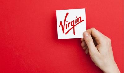 hand holding Virgin logo