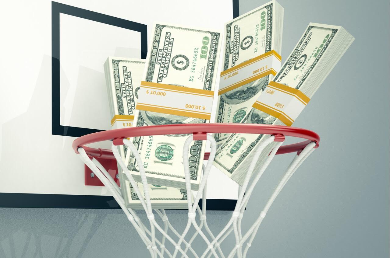bricks of money in basketball hoop