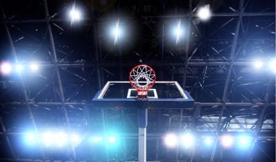 low angle shot of basketball hoop and lights