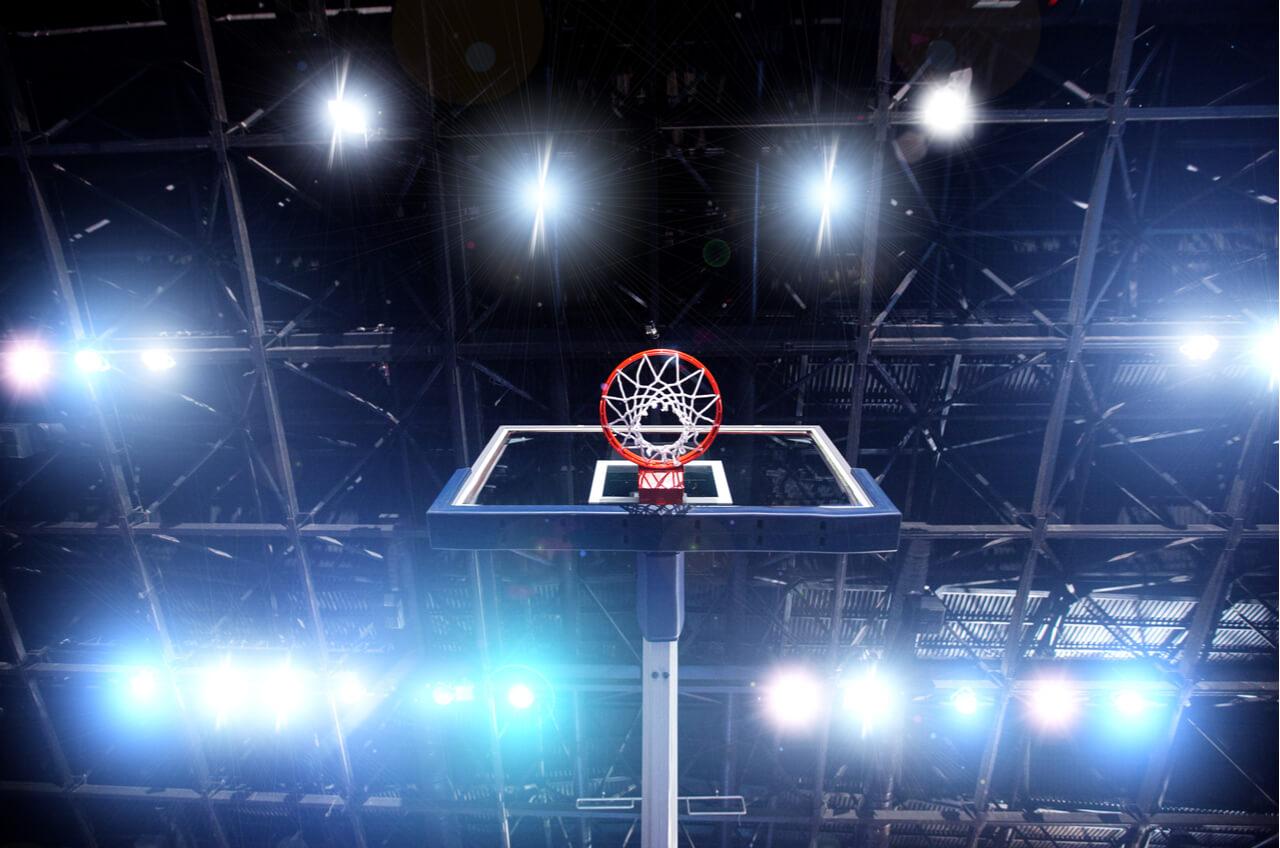 low angle shot of basketball hoop and lights