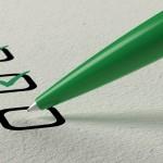 green pen checking off boxes